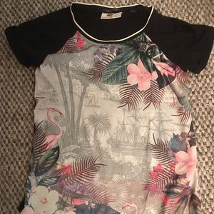 Front Tropical print t shirt. Solid back.